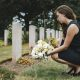 Insight Legal Solutions: young woman lays flowers at grave while preparing to take on the role of Executor for the Estate